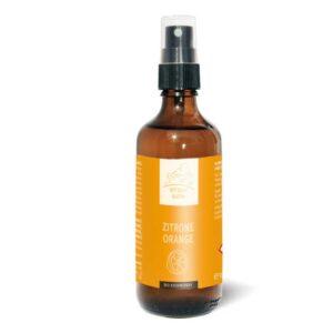 Flasche mit einem Zitrone-Orange Kissenspray